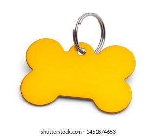 Gold Bone Dog Tag Isolated on White.