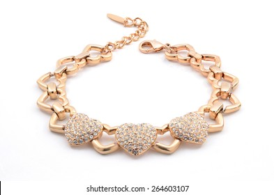 gold bracelet with hearts on a white background