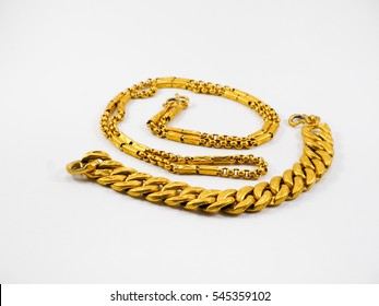 gold bracelet and gold necklace isolated on white background