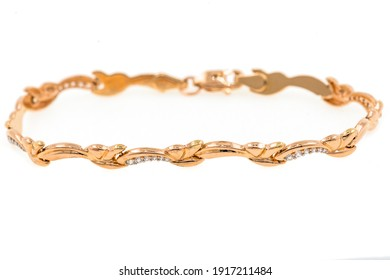 Gold bracelet on a white background. Horizontal close-up photo. Still life photography