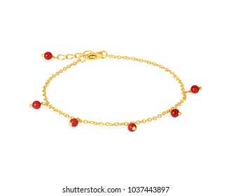Gold bracelet with red Beads