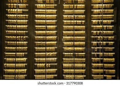 Gold bracelet showcase near Grand bazaar. Turkish gold shop with many golden bracelet.