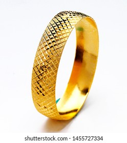 Gold bracelets isolated on white background