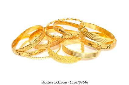 Lot of Gold bracelets on a white background