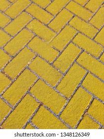 Gold Bricks in a Herringbone Pattern