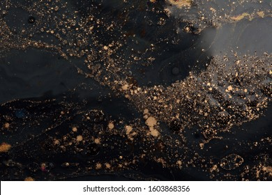 Gold (bronze) glitter shine dots confetti on black. Abstract light blink sparkle backgound