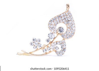 gold brooch with diamonds isolated on white