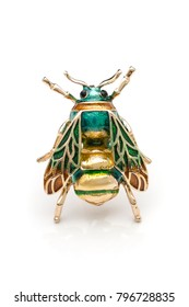 gold brooch enamel bee isolated on white