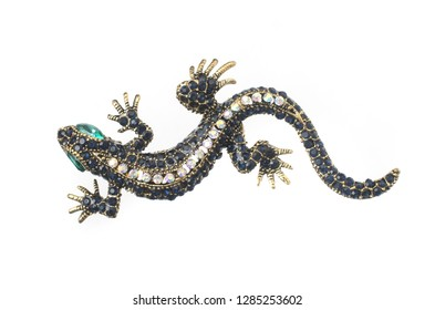 gold brooch lizard with gems isolated on white