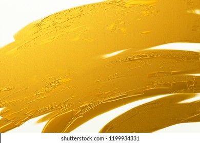 Gold brush stroke texture on white canvas background
