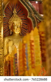 Gold buddha in Chiang mai Temple.The attitude of persuading the relatives not to quarrel.