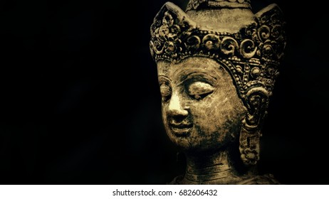 gold budha face,dark tone, black background