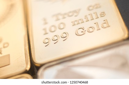 Gold bullion 999.9 purity solid one ounce ingot precious metal bars.