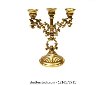 Gold candlestick on white background