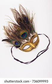 Gold a carnival mask with feathers on white background