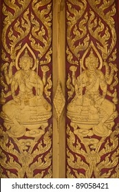 Gold carved ancient doors of temple