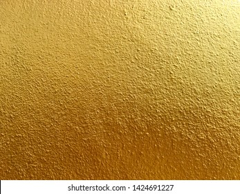 Gold cement wall background and texture design