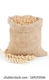 Gold cereal grains in linen sack