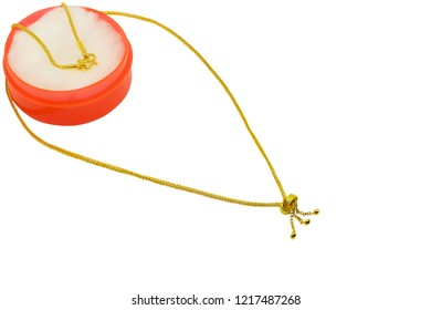 479271350d001 Gold chain necklace on white background with copy space.