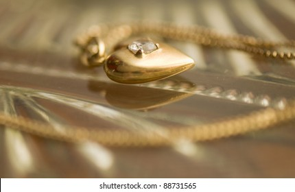gold chain and pendant the heart