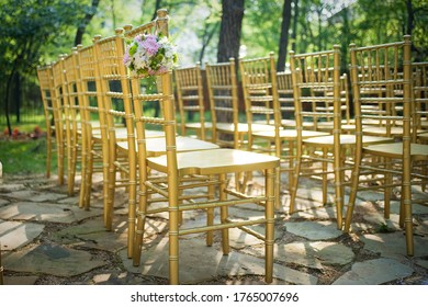 gold chairs set up for wedding