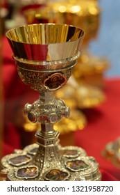 Gold chalices or goblets for sale in a shop window
