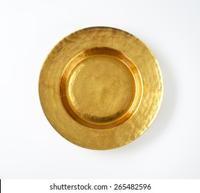 Gold charger plate with wide rim