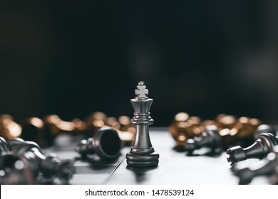 Gold Chess game king winner staying victory on chessboard,Business planing strong concept with black background