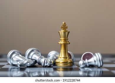 gold Chess king figure stand out from crowd of enermy or opponent during chessboard competition. Strategy, Success, management, business planning, disruption, win and leadership concept