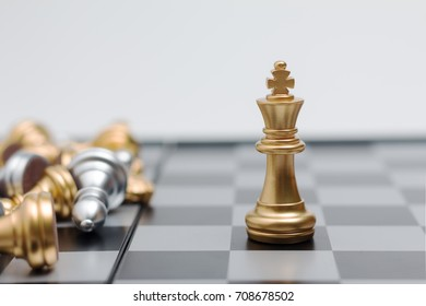 Gold Chess on chess board game for business metaphor leadership concept select focus on king chess shallow depth of field
