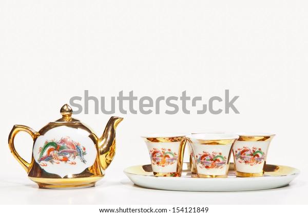 Gold chinese tea set isolated on white