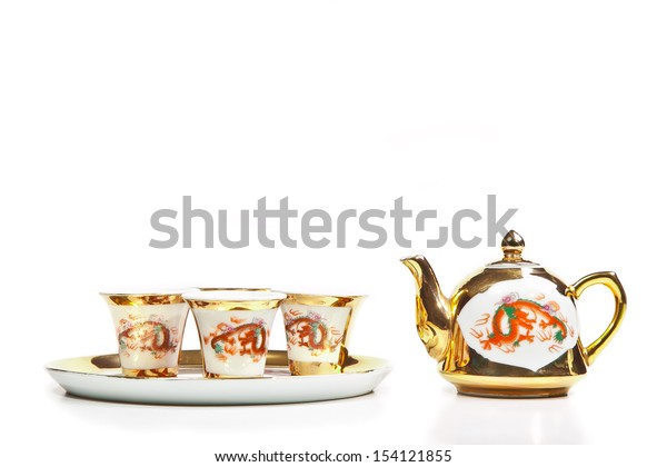 Gold chinese tea set isolated on white