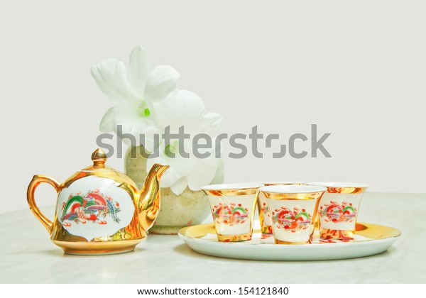 Gold chinese tea set on marble table
