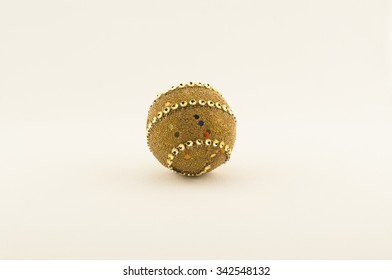 gold christmas ball over white background