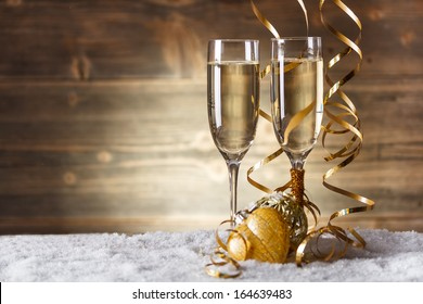 Gold Christmas balls with glass of fizz
