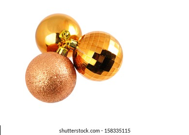 Gold christmas baubles isolated on white background