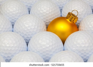 Gold  Christmas decoration between the white golf balls