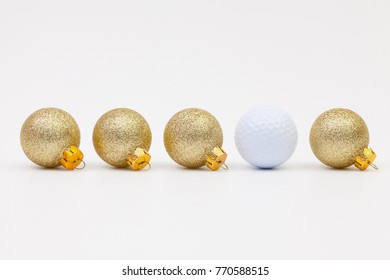 Gold Christmas decoration and white golf ball on the white background