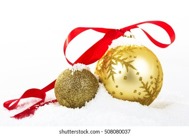Gold Christmas decorations in white snow for a background
