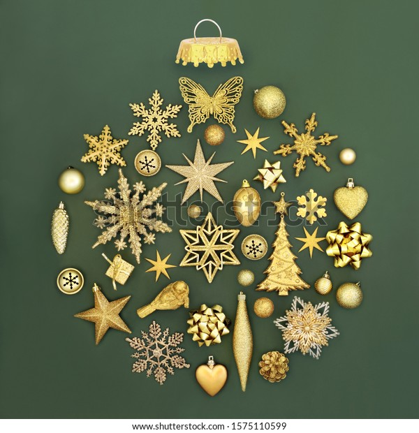 Gold Christmas tree decorations in gold forming an abstract bauble ornament on green background. Traditional symbols for the festive season.