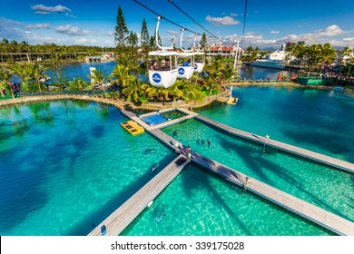 GOLD COAST, AUS - JUL 21 2015: Visitors ride on Sky High Skyway in Sea World Gold Coast Australia. It's sea animals theme park that promote conservation of marine wildlife.