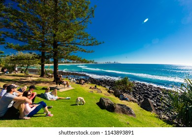 GOLD COAST, AUS - JULY 8 2018: People watching Gold Coast skyline and surfing beach at Burleigh Heads, Queensland, Australia