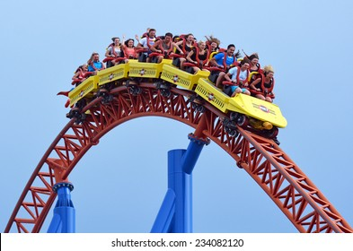 GOLD COAST, AUS -  NOV 06 2014:Visitors ride on Superman Escape in Movie World Gold Coast Queensland Australia.It's an Accelerator Coaster that accelerates from 0 to 100 Km per hour (62 mph) in 2 sec.