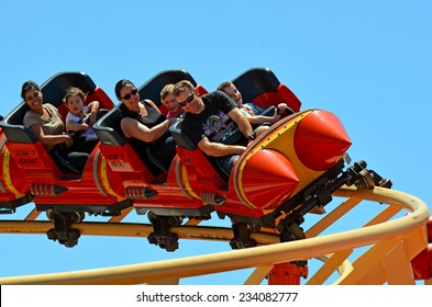 GOLD COAST, AUS -  NOV 06 2014:Visitors ride on Road Runner Roller Coaster in Movie World Gold Coast Australia.It's a 335-metre (1,099 ft) Junior Coaster reaches a top speed of 45.9 km/h (28.5 mph)