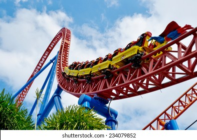 GOLD COAST, AUS -  NOV 20 2014:Visitors ride on Superman Escape in Movie World Gold Coast Queensland Australia.It's an Accelerator Coaster that accelerates from 0 to 100 Km per hour (62 mph) in 2 sec.