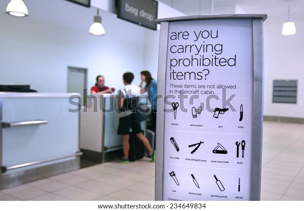 GOLD COAST, AUS - NOV 22 2014:Passengers in check in desk.For the safety and security air travelers airlines have prohibited certain items from brought onto airplanes in carry-on and/or checked bags.