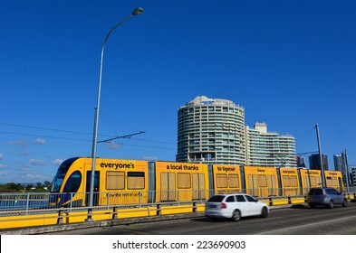 GOLD COAST, AUS - OCT 13 2014:Gold Coast Light Rail G cross over Sundale Bridge and Southport skyline in Gold Coast Queensland, Australia.The line opened on July 2014 and it 13 Km (8.1 mi) long.