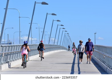 GOLD COAST, AUS - OCT 13 2014:People cross over Sundale BridgeThe bridge span across the Nerang River in Southport Gold Coast Queensland Australia.