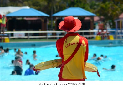 GOLD COAST, AUS - OCT 30 2014:Australian Lifeguard in Wet'n'Wild Gold Coast Australia.They are world-renown for their high levels of skill and knowledge in accident prevention and rescue response