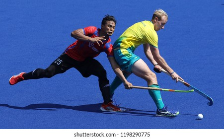 GOLD COAST, AUSTRALIA - APRIL 03, 2018 : Australia (R) and Malaysia player in action during Men Hockey match Gold Coast 2018 Commonwealth Games at Gold Coast Hockey Centre.